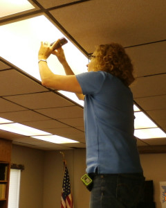 Jess Scott checks fluorescent fixture ballasts